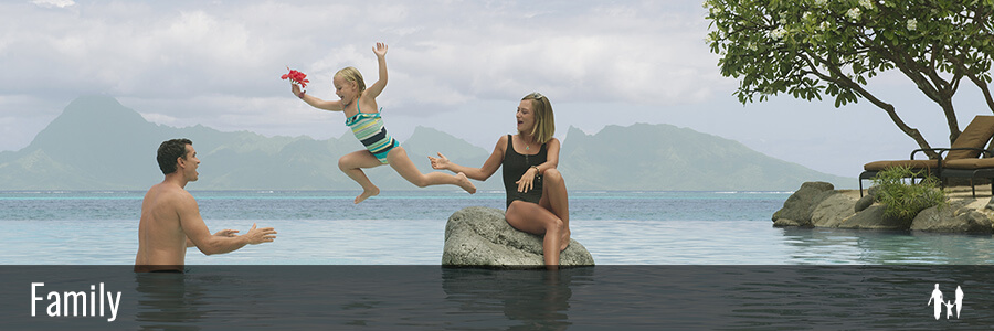 Family playing in the swimming pool of the intercontinental Tahiti