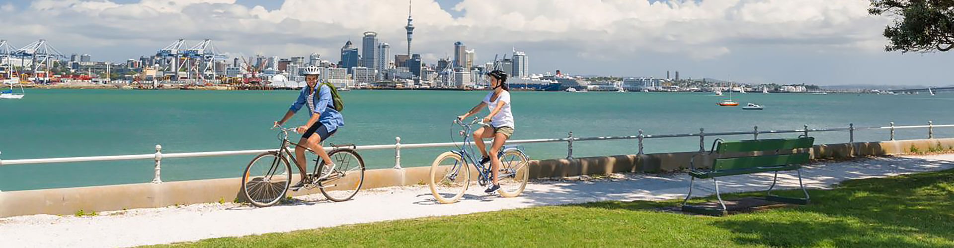 Couple riding bikes in Auckland, New Zealand