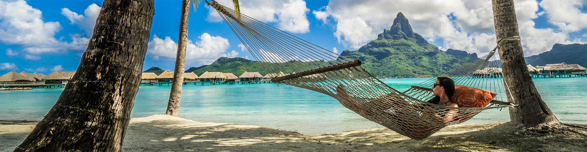 Woman relaxing in hammock in the Tahitian Islands