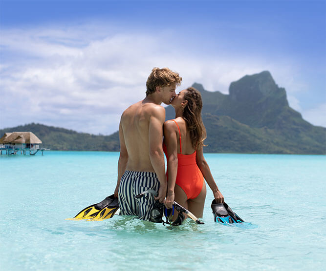 Couple kissing in a lagoon in Bora Bora