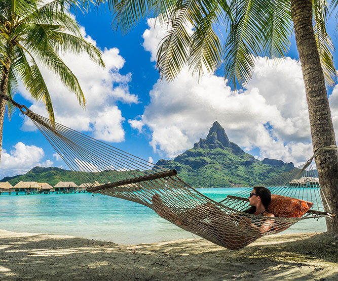 Woman relaxing in a hammock in Bora Bora