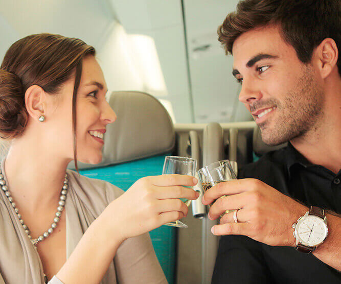 Couple drinking champagne in the Air Tahiti Nui Poerava Business Class