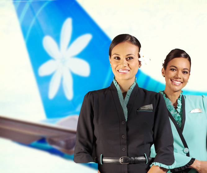 three Air Tahiti Nui flights attendant smiling with the Air Tahiti Nui aircraft behind