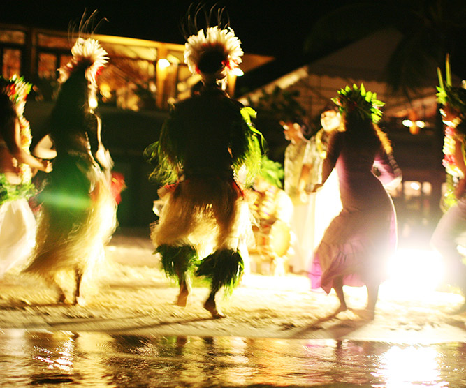 people dancing by night in the islands of tahiti