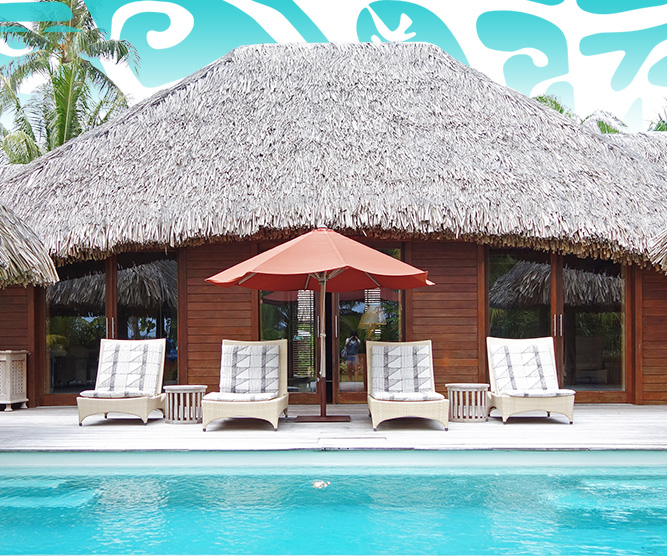day bed in front of a swimimng pool in bora bora