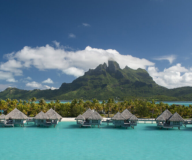 hotel overwater bungallows in bora bora with the lagoon and bora bora mountain