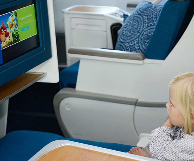 kids on board air tahiti nui watching screen