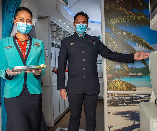 Flight attendant wearing mask