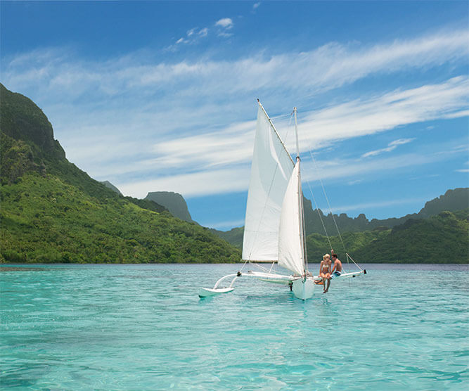 Couple on sailboat in Moorea