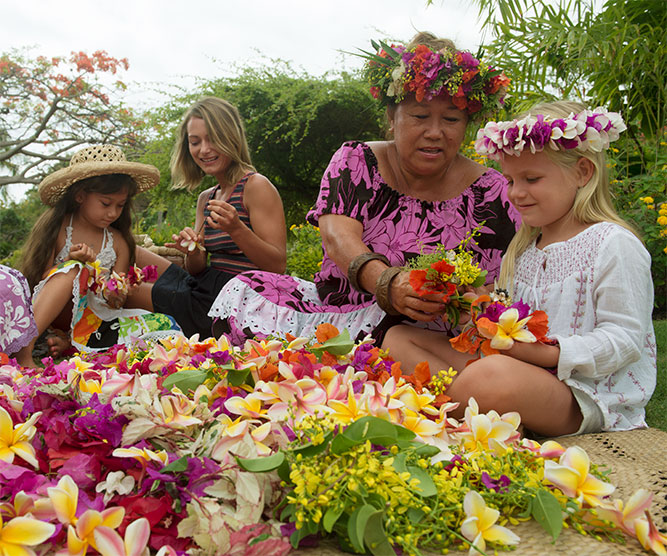 Tahitians with Family working with native flowers