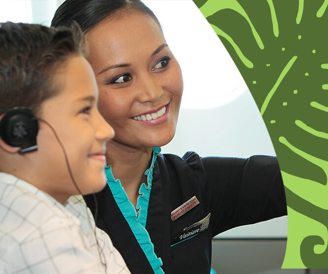 air tahiti nui flight attendant helping a kid