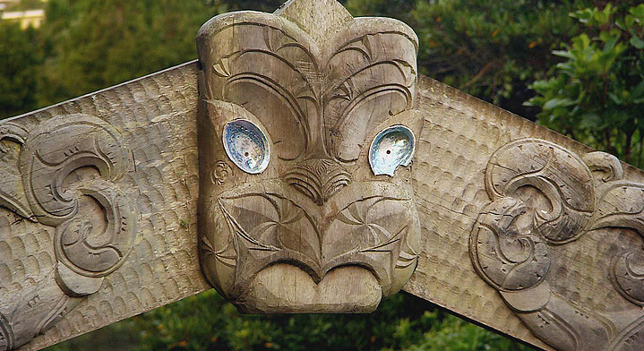 Photo of a sculpture in wood of a tiki