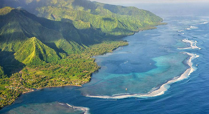 aeral view of the island of tahiti with the mountain, the lagoon and the ocean