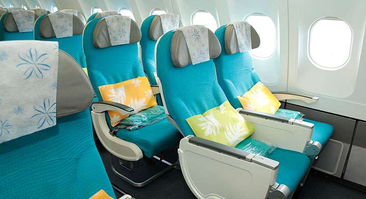 Blue seats of the Economy class cabin of Air Tahiti Nui