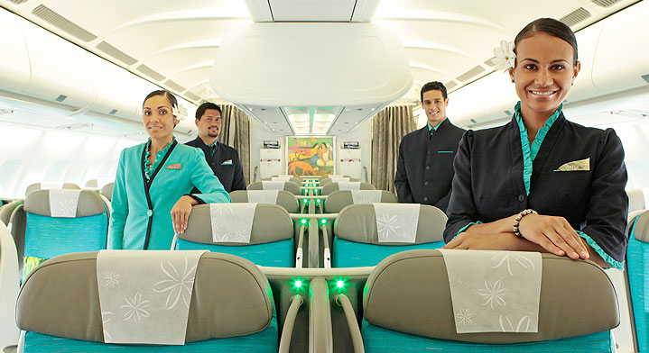 4 smiling flight attendants in the Poerava Business Class of Air Tahiti Nui