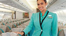 Air Tahiti Nui flight attendant welcoming you onboard