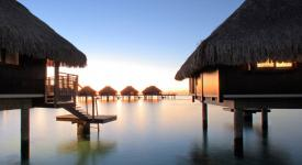 view of a french polynesia beach and overwater bungalows