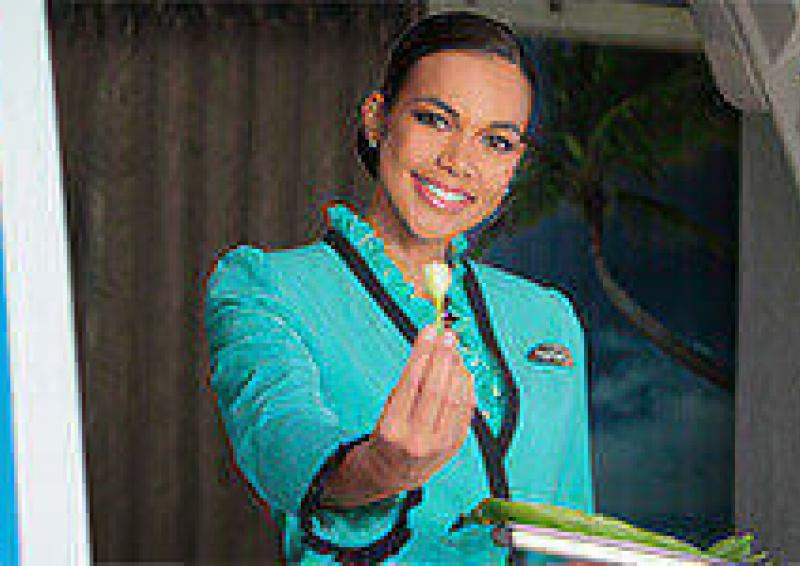The Spirit of Air Tahiti Nui - Flight attendant offering tiare flower