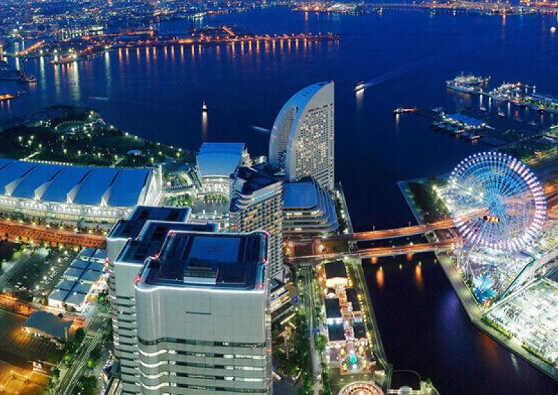 aerial view of buildings and see of tokyo at night