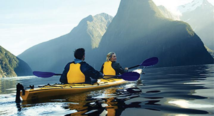Auckland Adventures Image - Two people kayaking in New Zealand