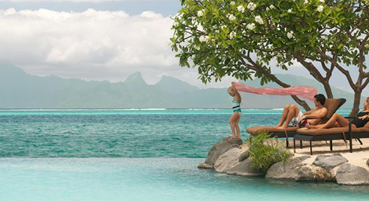 Family relaxing by the pool in Tahiti - Family Offer