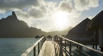 view of the mont otemanu at bora bora with overwater bungalow and pontoon