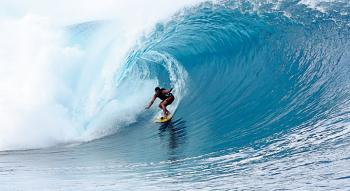 Photo of a surfer in a big wave in Teahupoo Tahiti
