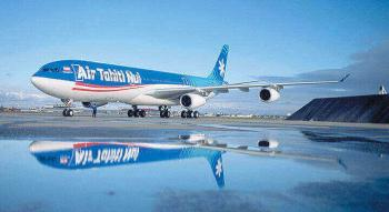 photo of an Air Tahiti Nui Aircraft on the tarmac with its reflection in a puddle