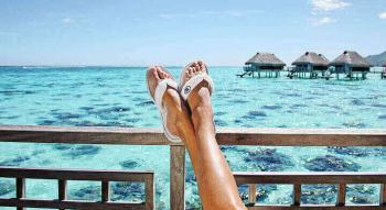 woman relaxing on overwater bungallow of bora bora