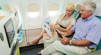 view of a couple watching the Air Tahiti nui duty free magazine seating in poerava business class
