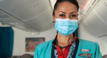 Air Tahiti Nui flight attendant with mask