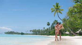Couple at the water's edge in Tahiti