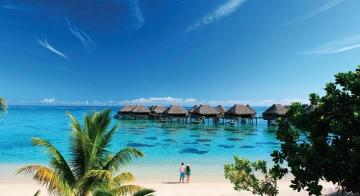 A couple by the beach at Hilton Moorea Resort & Spa