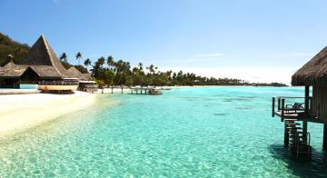 View of the beautiful beach surrounding the Sofitel Moorea Ia Ora Beach Resort