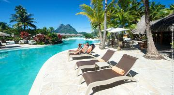 A couple on deck chairs at the Bora Bora Pearl Resort