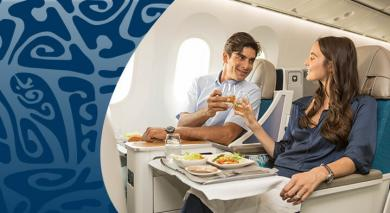 couple en classe poerava business air tahiti nui prenant un repas