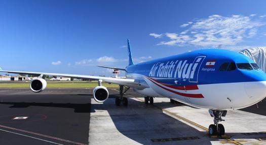 Photo of an Air Tahiti Nui Air Craft on the tarmac at Faa'a Airport