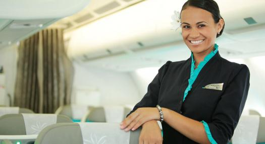 A flight attendant in the Poerava Business Class of Air Tahiti Nui