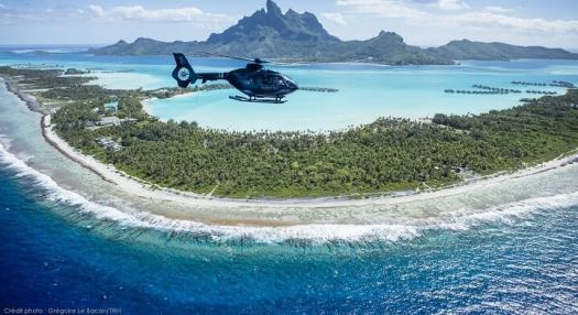 Picture of Tahiti Nui Helicopter flying over the island of Bora Bora