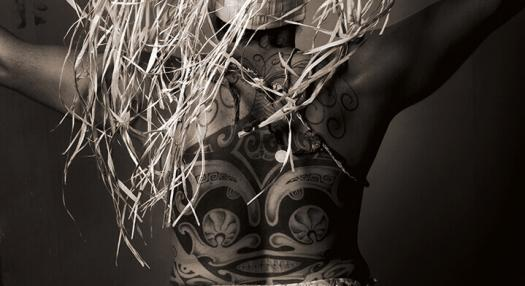 Photo of a man with a Tahitian tattoo on the back