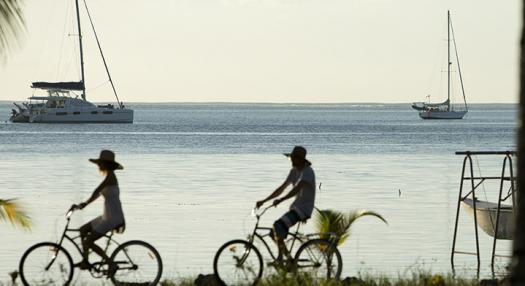 couple doing bycycle in the hidden islands of tahiti