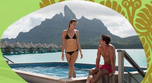 couple in bora bora hotel swiming pool
