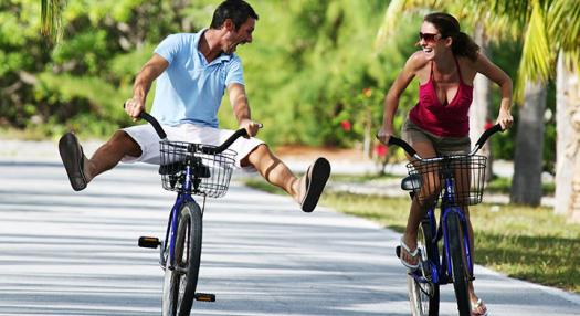A couple riding bikes and having fun in the islands of Tahiti