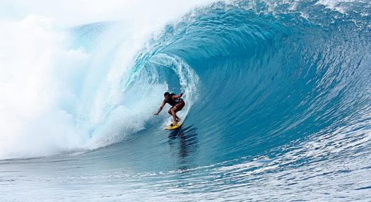 Man surfing Teahupoo big waves in the island of Tahiti