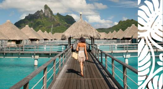 woman walking on overwater bungalow hotel in bora bora