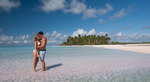 a couple kissing in the Tuamotu's islands