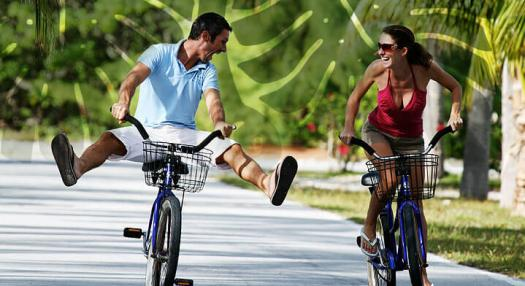 couple doing bycicle in tahaa island