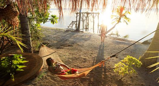 Couple in an hammock on the beach