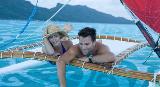 couple relaxing on a tahitian pirogue