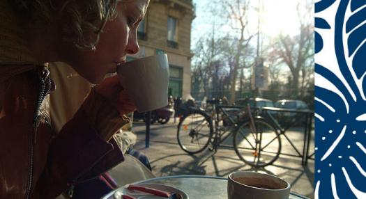 woman drinking coffee in paris